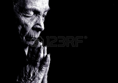 10946984-portrait-on-black-of-old-woman-praying
